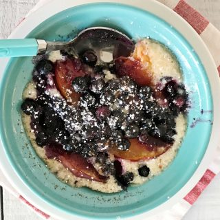 Easy gluten-free and vegan blueberry peach cobbler baked up in a mug in the microwave